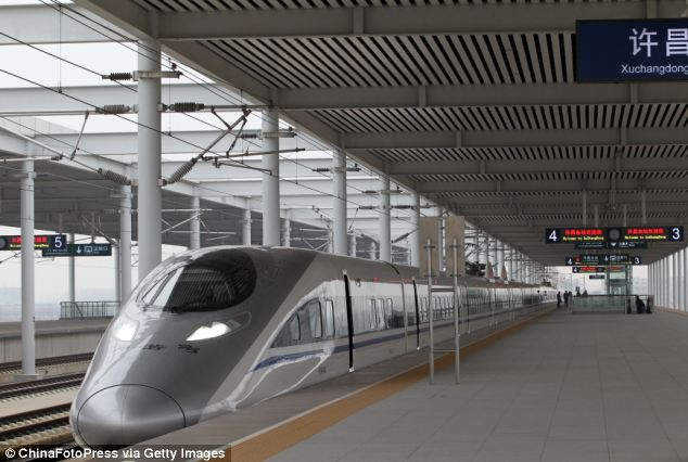 Brand new: A high speed train sits on the platform of the new rail link between capital city Beijing and Guangzhou in the south