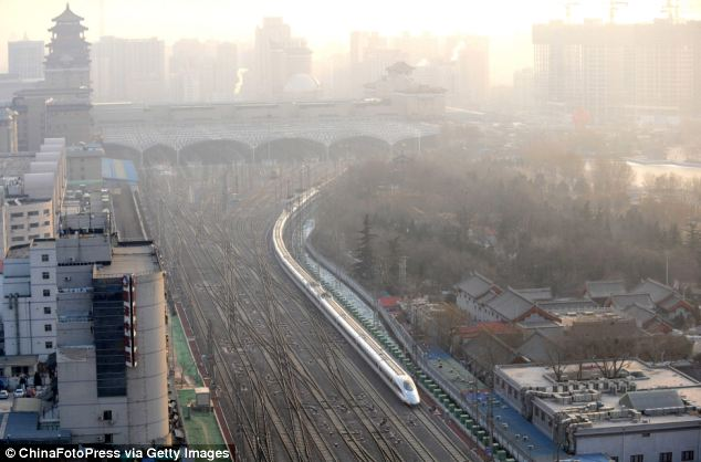 Speedy: Running at an average speed of 300 kilometers per hour, the 2,298-kilometer new route will cut the travel time between Beijing and Guangzhou from more than 20 hours to around eight