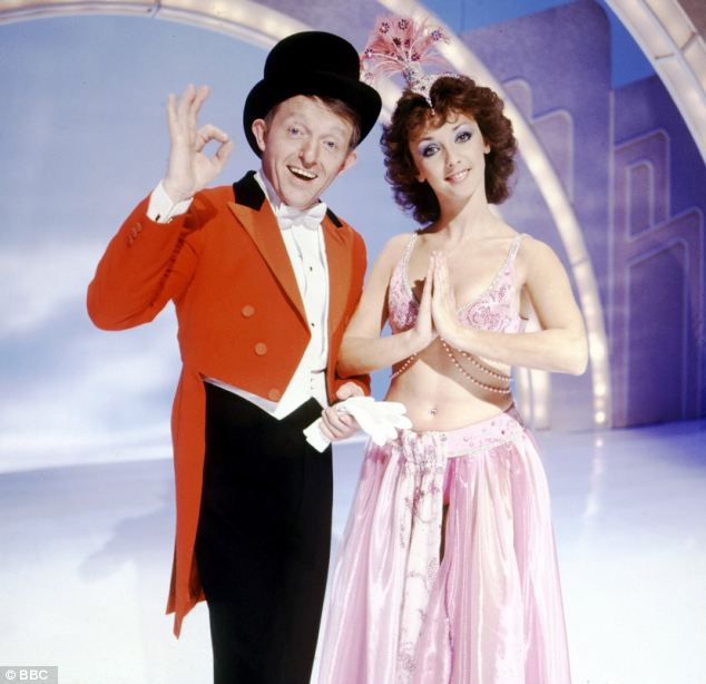 Under fire: Magician Paul Daniels on stage with his wife Debbie McGee