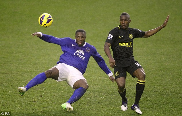Tussle: Everton's Victor Anichebe (left) and Wigan star Maynor Figueroa battle for the ball