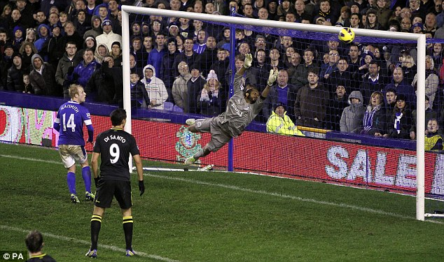 Stretch too far: Wigan keeper Al Habsi fails to stop Jagielka's header as Steven Naismith watches the ball go in