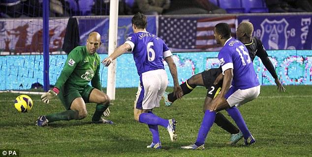 Lifeline: Arouna Kone (right) scored late on as Wigan pressed