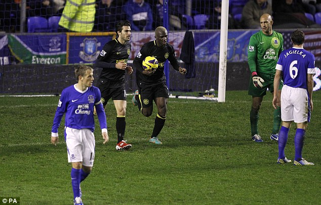 Too little, too late: Kone was keen to get on with things after his goal but Wigan couldn't find a second