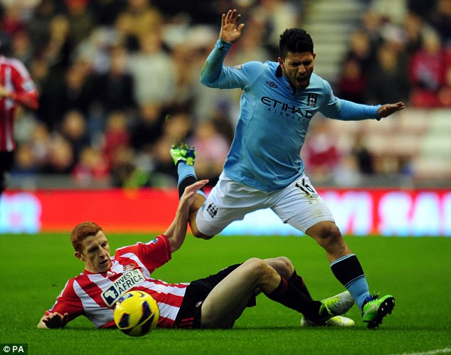 Stopped in his tracks: Sergio Aguero is halted by Colback