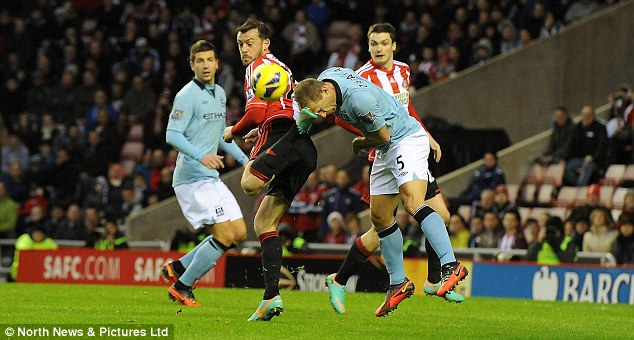 In the wars: Pablo Zabaleta gets a cut after Steven Fletcher catches him with his boot