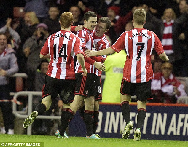 Making the difference: Adam Johnson celebrates scoring against City