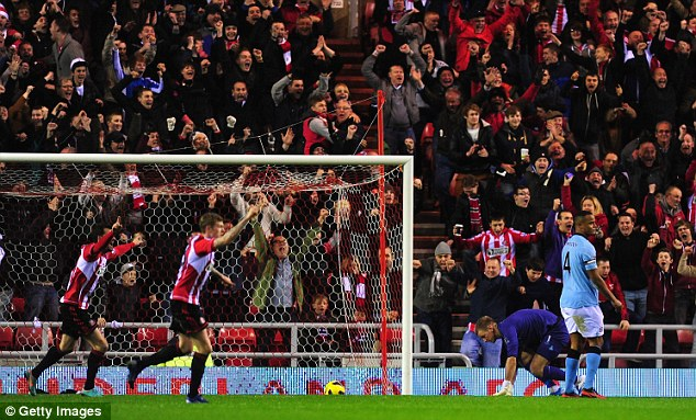 Mixed emotions: The Sunderland players and fans celebrate as Hart and Kompany look on
