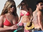 Bikini time! Jennifer Aniston spent Christmas Eve sunbathing in Cabo, Mexico