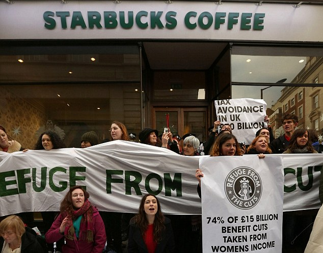 Wake up and smell the coffee: Starbucks has offered to pre-pay £20million, after UK UNCUT held protests outside several outlets of the chain.