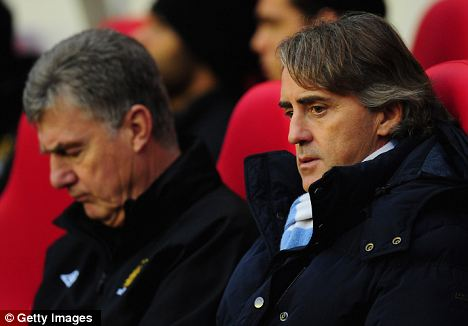 Out of touch: Manchester City manager Roberto Mancini (right)