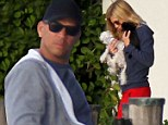 The dog days aren't over... A-Rod looks grumpy as girlfriend Torrie Wilson fusses over her three pups on cruise