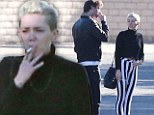 'It's showtime!' Miley rocks the jailhouse look in Beetlejuice trousers... on trip to Palm Springs with fiance Liam Hemsworth