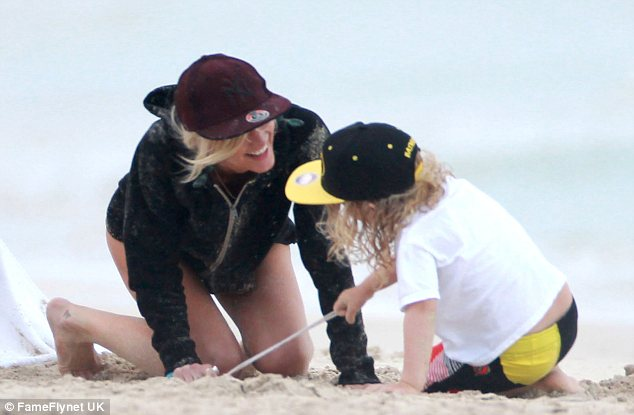 Sandy: Ashlee's black hoody seemed to attract a lot of the yellow stuff as she got on her hands and knees with Bronx