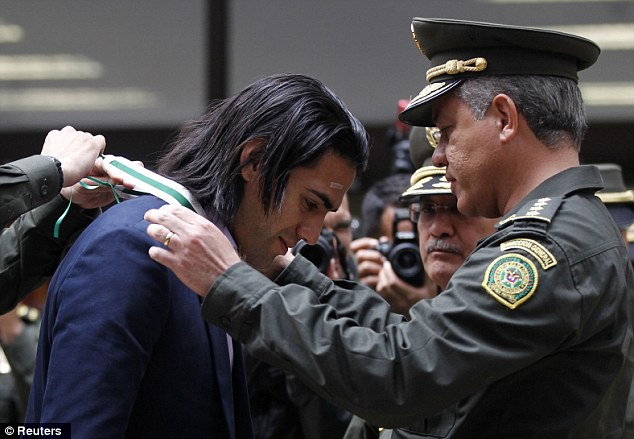 Award: Falcao spent Boxing Day in his native Columbia as he received an Excellent Citizen Award from Colombian Police General Director Jose Leon in Bogota