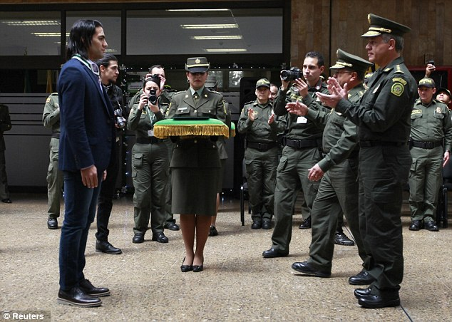 Colombian Chief General Jose Leon Riano applauds