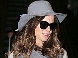 What's under the hat: Kate Beckinsale headed off on vacation from LAX airport on Wednesday with her daughter Lily, and husband Len Wiseman