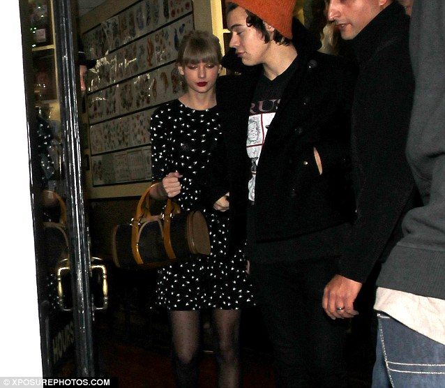 Doting girlfriend: Taylor didn't appear to have followed Harry's lead and gone for any body art herself