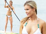 Sparkling beach bunny! Joanna Krupa shows off toned figure in bejeweled bikini... while paddle boarding in Miami
