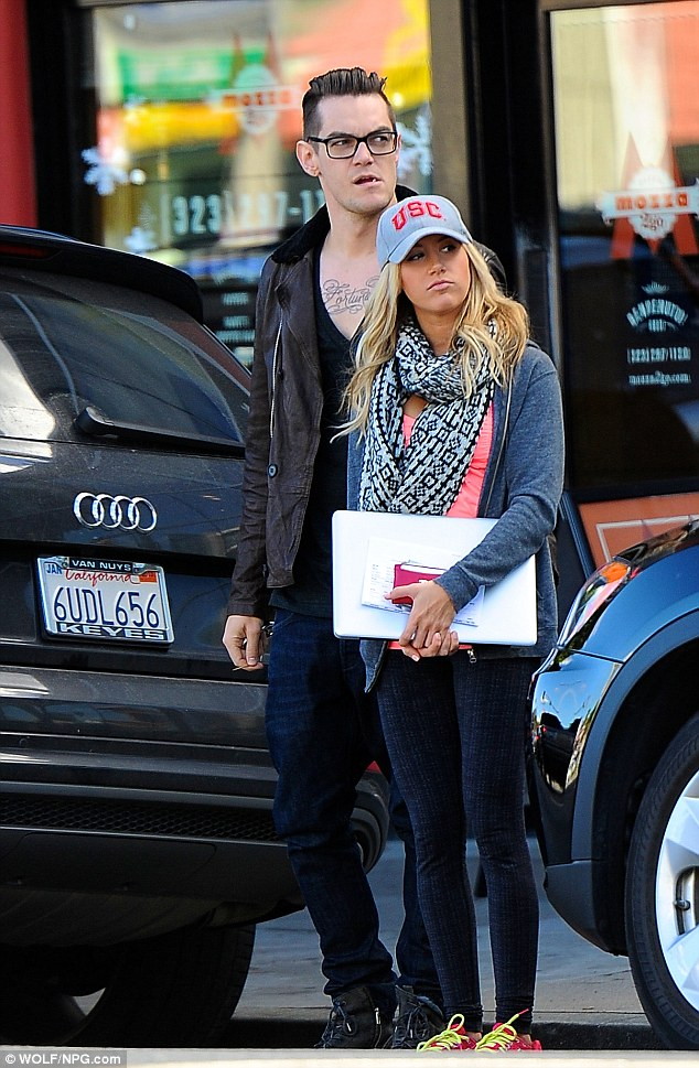 Stuck on each other: Ashley Tisdale stepped out for an errand to the Apple store in Los Angeles with new beau Christopher French on Wednesday