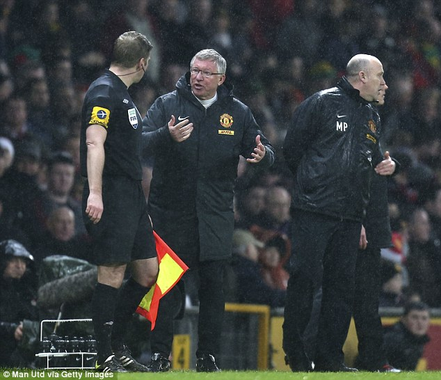 Harangued: Ferguson also protested with assistant referee Jake Collin during the Boxing Day encounter
