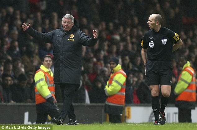 Complaint: Ferguson has words with Mike Dean after a Jonny Evans own goal was allowed to stand despite Newcastle's Papiss Cisse standing in an offside position