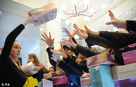 Competitive: Shoppers scramble for perfume in Selfridges on London's Oxford Street on Boxing Day