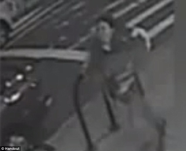 The unidentified woman, seen fleeing on video, was reportedly muttering to herself