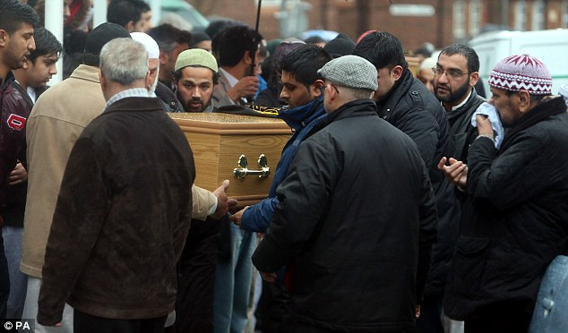 Mourners carry the coffin of one of the two boys into a mosque in High Wycombe, Buckinghamshire