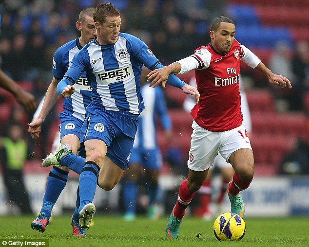 Main striker: Theo Waclott (right) continues in the lone forward role for Arsenal