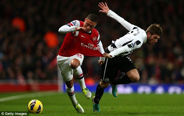 On the pull: Newcastle's Davide Santon tugs the shirt of Arsenal's Alex Oxlade-Chamberlain