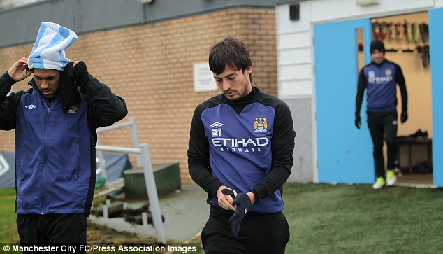 Battle cry: David Silva is determined to catch Manchester United at the top of the Premier League