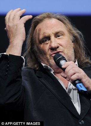 Taxi!: Hollande's flagship policy caused uproar in the business community, while actor Gerard Depardieu announced he would go to live in Belgium to escape the higher tax