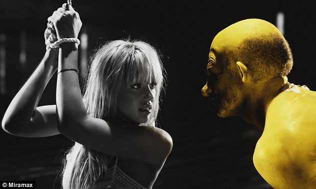 Impressive body of work: Nick also appeared in 2005's Sin City, and is pictured here in a scene with Jessica Alba