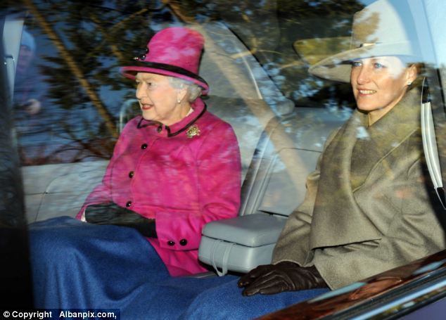 Cheerful: Sophie Countess of Wessex smiled as she was pictured sat alongside the Queen as the pair attended mass at Sandringham this morning