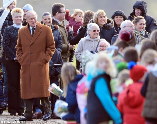 Sunday stroll: Prince Philip, who was too ill to attend last year's service due to a heart problem, walked to church at Sandringham this morning