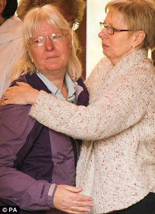 Support: Mrs Greaves is comforted after she attended the church service where she thanked the congregation for their help