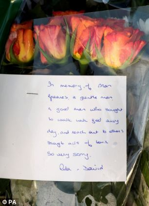 Flowers left at the scene near St Saviour's church where Mr Greaves was attacked