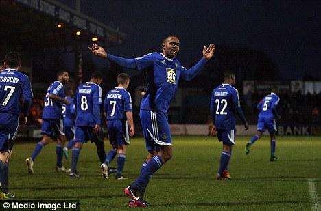 Stormy: Mathew Barnes-Homer celebrates his goal against Barrow