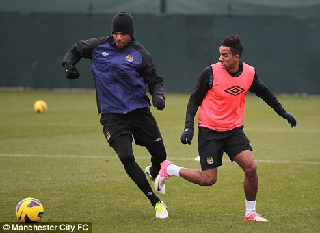 Frozen out: Sinclair (right) has hardly featured for Man City this season