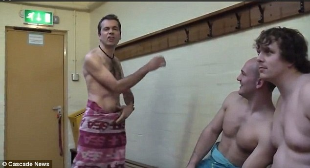At one point staff pose in the changing rooms in only their towels