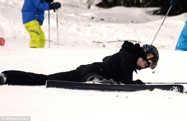 Face plant: Madonna was seen lying face down in the snow with her legs splayed out after falling over