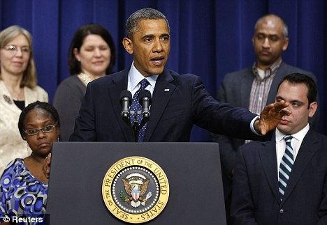 Brave face: US President Barack Obama speaks about the fiscal cliff negotiations on December 31