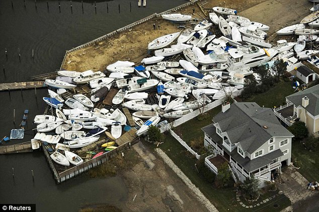 Disaster: Boats are seen in a yard, where they washed onto shore during Hurricane Sandy, near Monmouth Beach, New Jersey after the storm lashed the East Coast