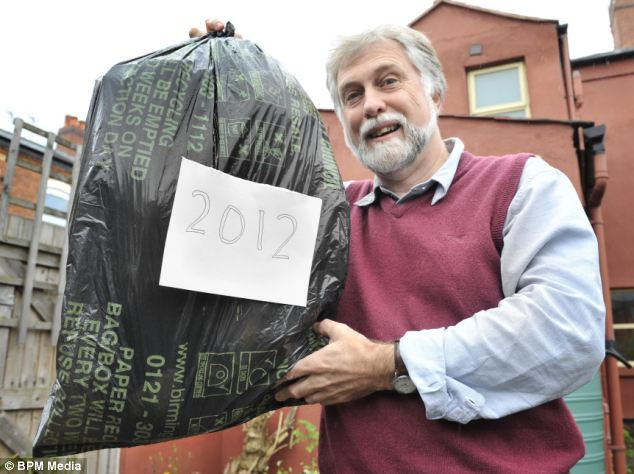Proud recycler John Newson with his only bag of rubbish in 2012, after he resolved to recycle or compost most of his waste