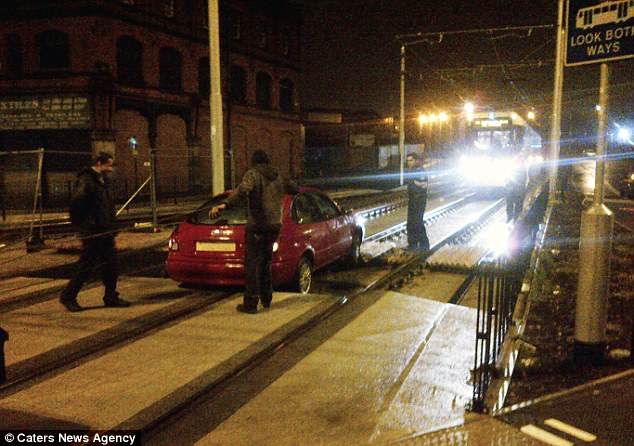 The quick thinking tram driver managed to stop just before crashing into the red Toyota. It is thought the driver had mistaken the section of line, which runs from Oldham to Rochdale, for a side road