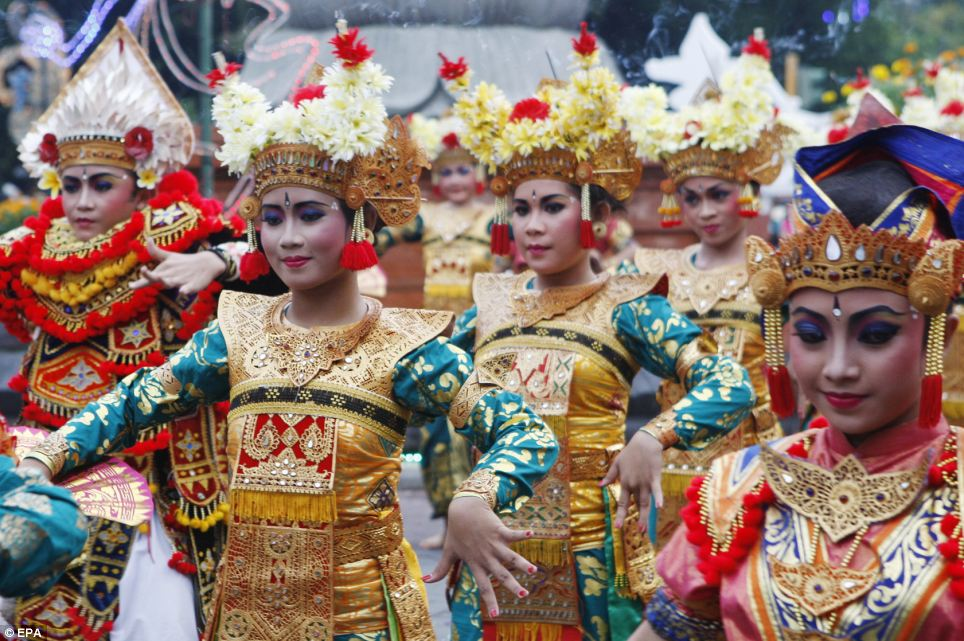 Colourful: Balinese dancers perform their traditional dance to welcome in 2013