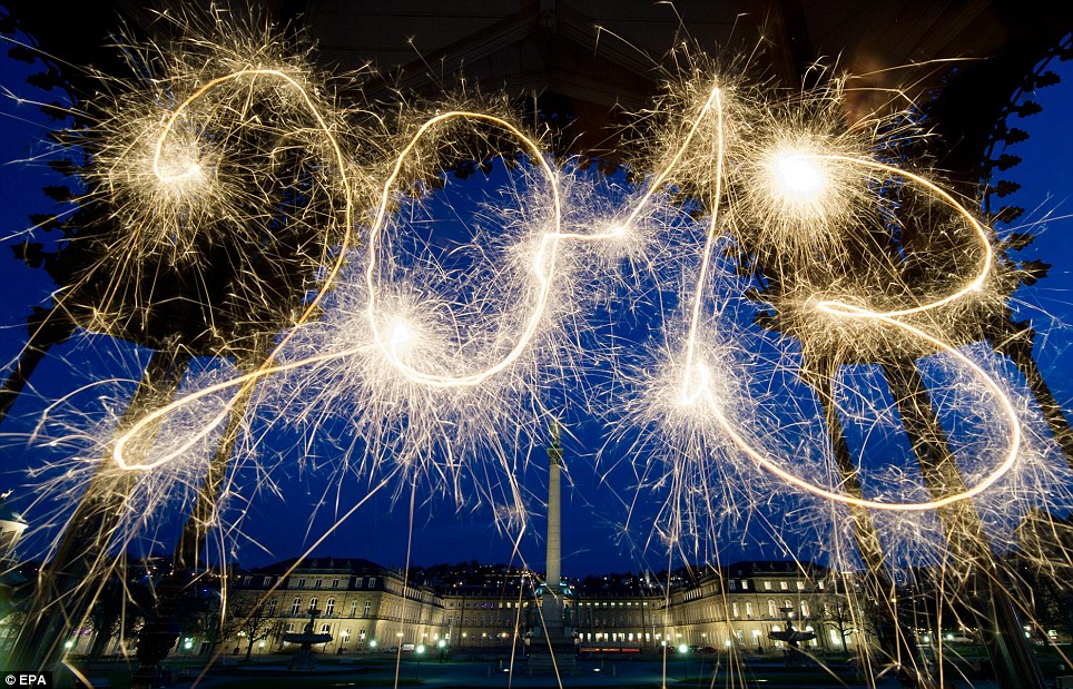 Original: The year 2013 is written with sparklers in front of the New Palace in Stuttgart, Germany