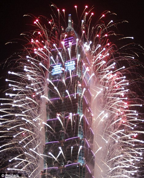 Fireworks explode from Taiwan's tallest skyscraper, the Taipei 101 during New Year celebrations in Taipei