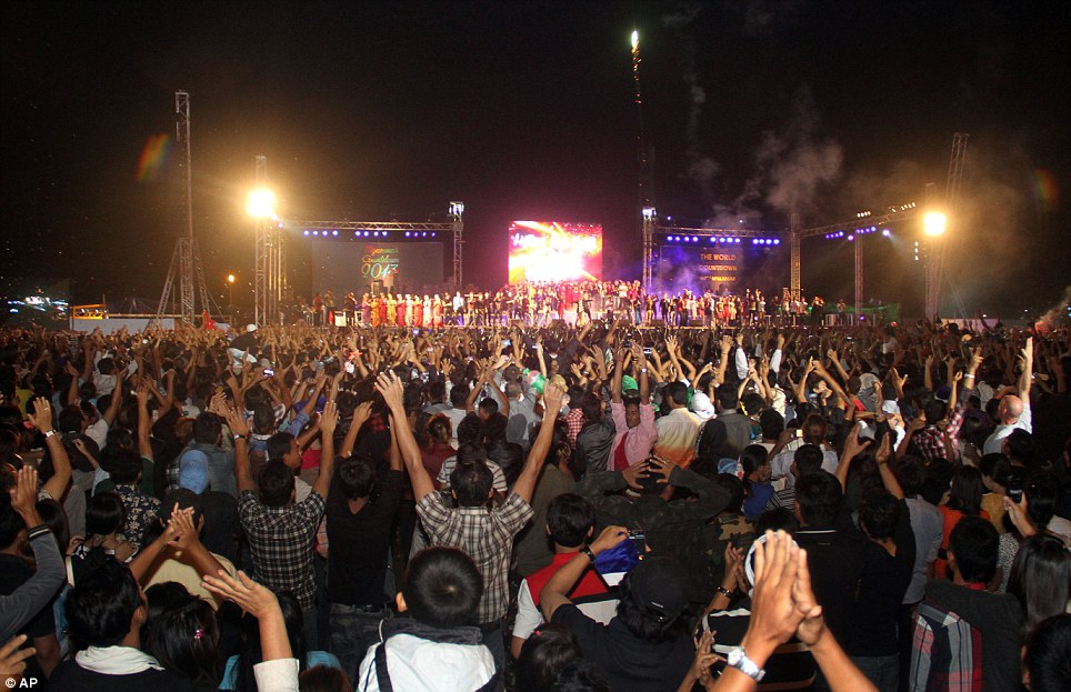 Historic: People cheer loudly as they welcome the 2013 New Year at the first ever public New Year Countdown celebration at Myoma grounds in Yangon, Mayanmar - also known as Burma
