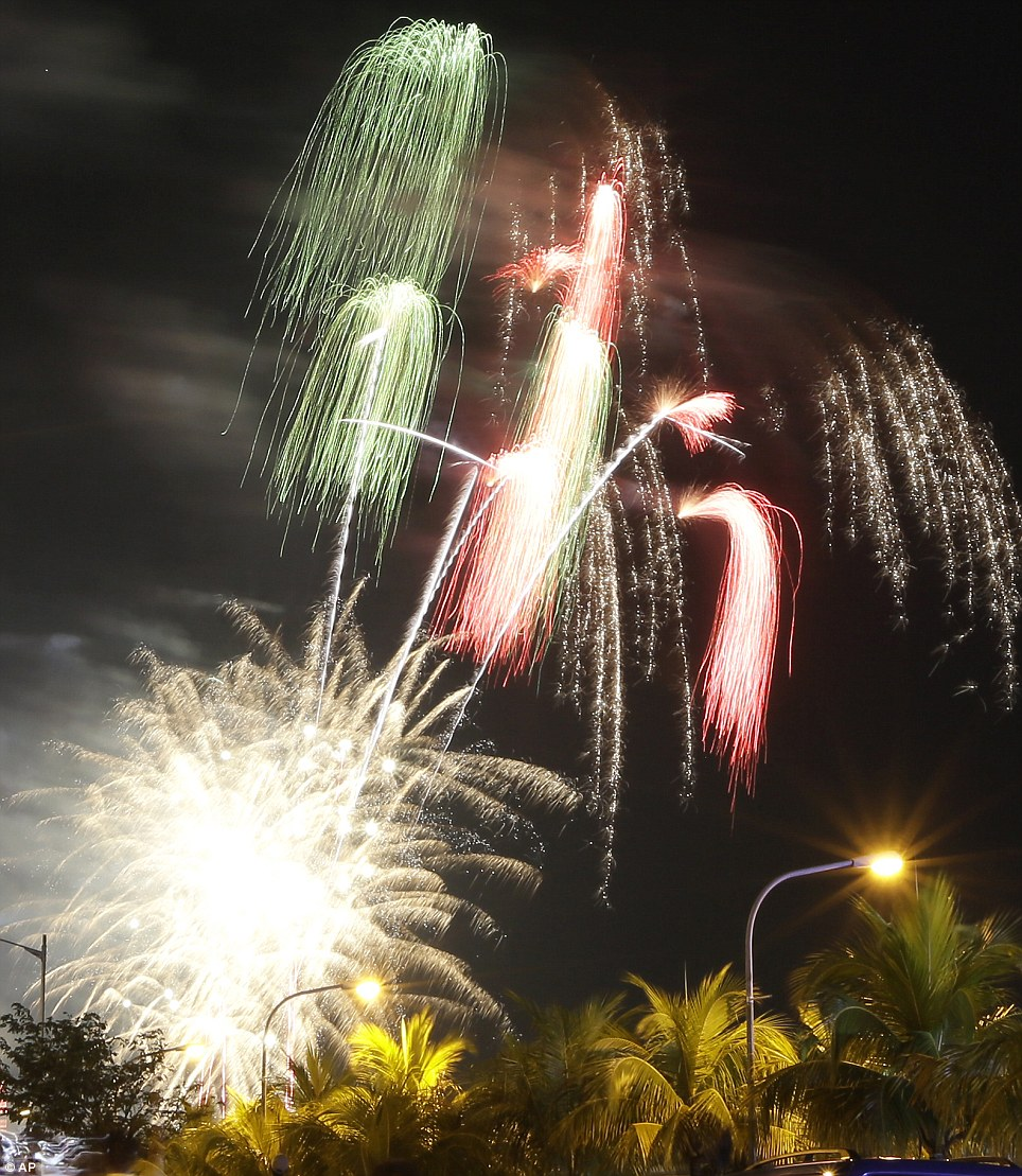 Celebration: Fireworks light up the sky to welcome the New Year at the scenic Manila Bay in Manila, Philippines